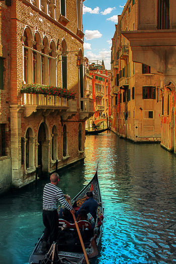 Rear view of man on boat in canal