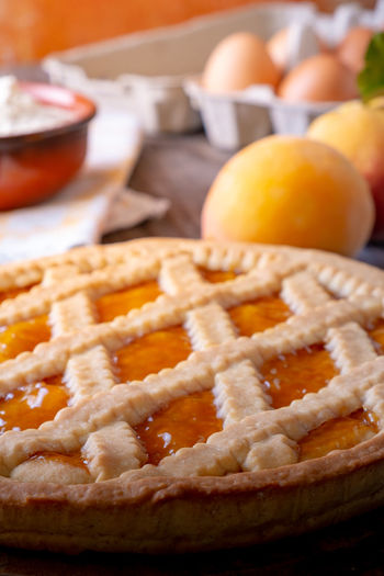 Tart with peach jam on wooden rustic table Apricot Baked Baked Pastry Item Breakfast Close-up Dessert Dough Focus On Foreground Food Food And Drink Freshness Fruit Healthy Eating Indoors  Meal No People Orange Pastry Dough Peaches Ready-to-eat Snack Sweet Food Sweet Pie
