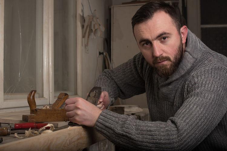Portrait of carpenter working at workshop