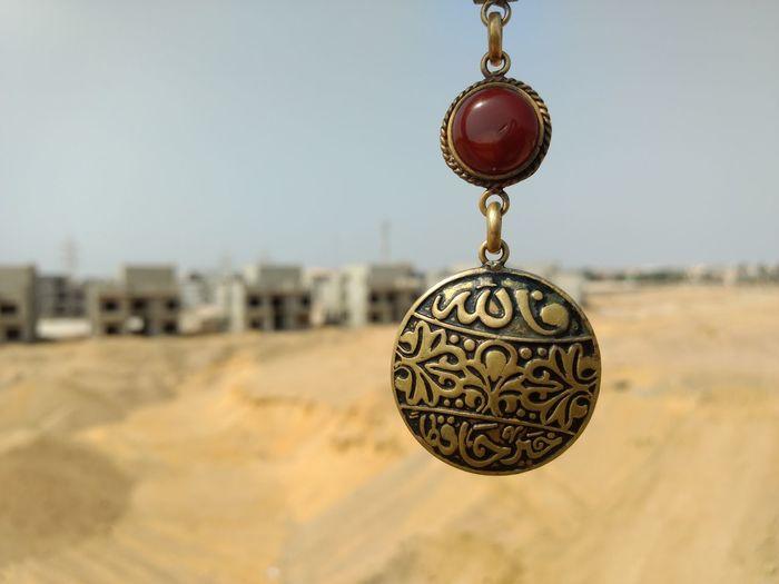 الله خير حافظاً No Edits No Filters Mobile Photographer ISLAM♥ Supplication Sand Islamic Art Medal Focus On Foreground Hanging Outdoors Sky Backgrounds Allah ❤❤