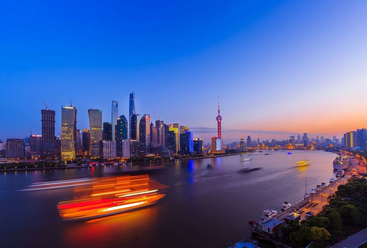 Blurred Motion Of Passenger Craft On Huangpu River At Sunset