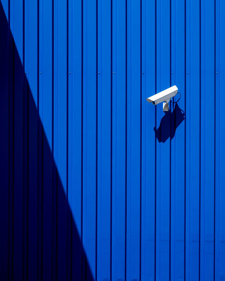 Bluebackground Blue No People Pattern Minimalism Minimalist Photography  Security Protection Safety Wall - Building Feature Architecture Built Structure Security Camera Shadow Closed Corrugated Backgrounds Sunlight Day 17.62°