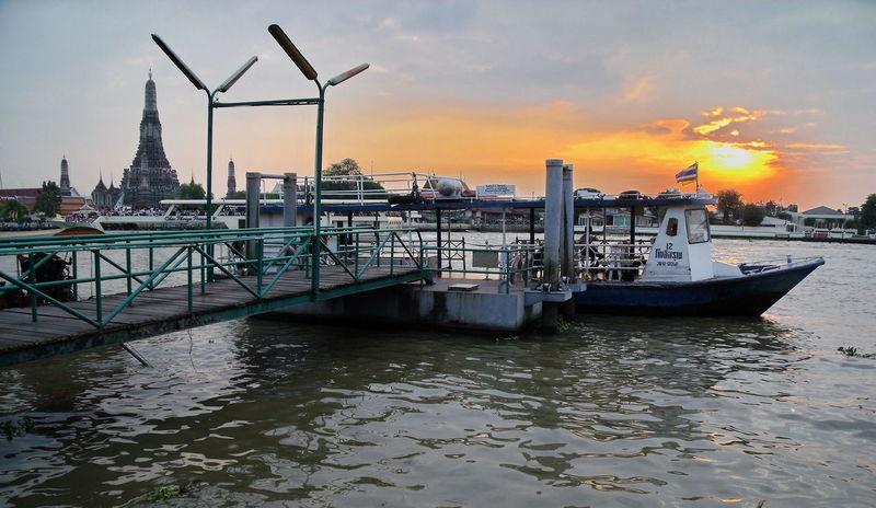 View chao phraya river at wat arun rajwararam temple background Temple Wat Arun River Sunset Colorful Boat Travle Port Water Bangkok Thailand. Bangkok