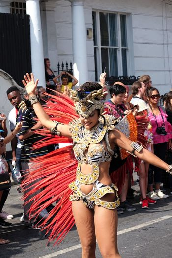Dancer, London School of Samba Composition Feathers Fun GB London Arts Culture And Entertainment Capital City Carnival Carnival Costume Dancer Dancing Famous Carnival Front View Full Frame Headdress Incidental People London School Of Samba Nottinghill Carnival 2017 Outdoor Photography Performance Performing Arts Event Raised Arms Red, Gold And Black Colour Uk Young Woman