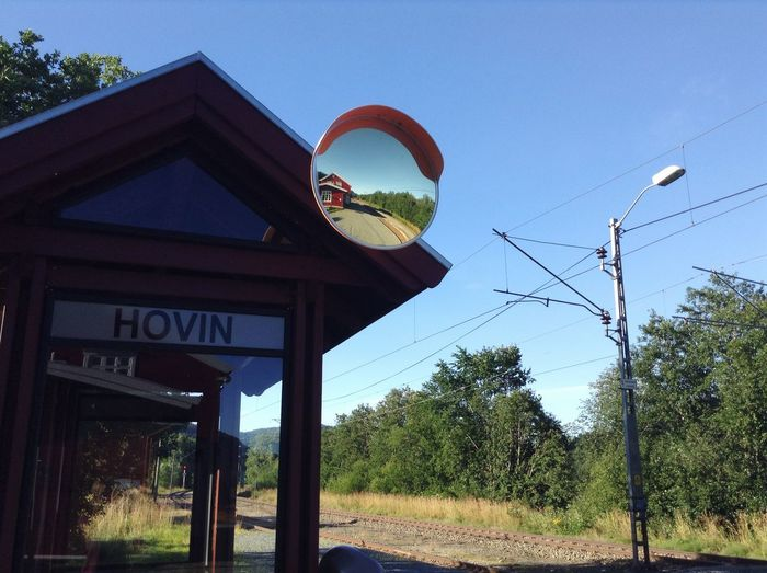 At the train station waiting. Waiting Hovin Train Train Tracks Mirror Blue Sky Nice Weather Trees Blue Green