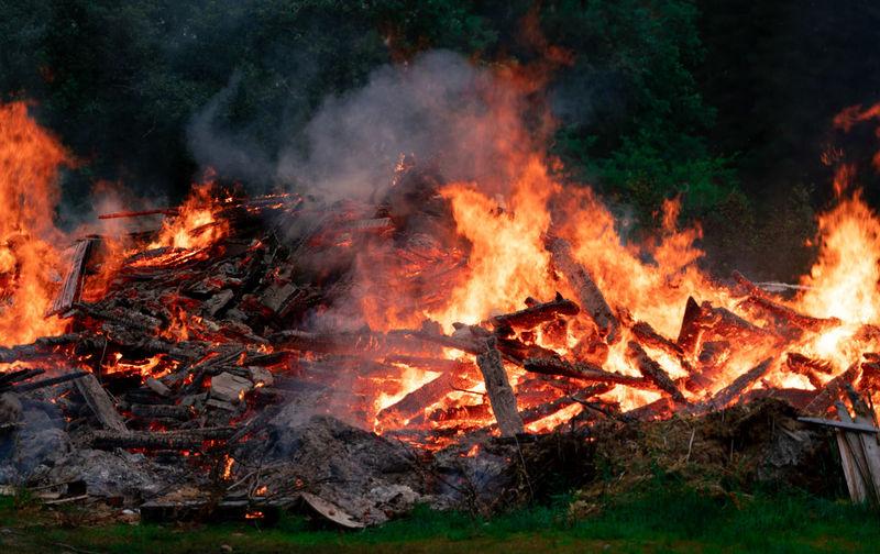 Midsummer bonfire Fire Burning Flame Heat - Temperature No People Wood Bonfire Outdoors Wood - Material Glowing Orange Color Midsummer Bonfire