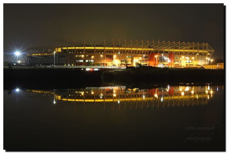 Illuminated Night Reflection Water Waterfront Built Structure Architecture Transfer Print No People Lighting Equipment Building Exterior Sky Auto Post Production Filter Nature River City Outdoors Light Symmetry Borobudur Riverside Stadium Middlesbrough Football Utb