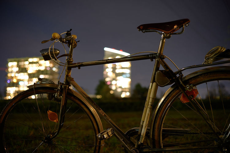 Close-up of bicycle parked on street against sky