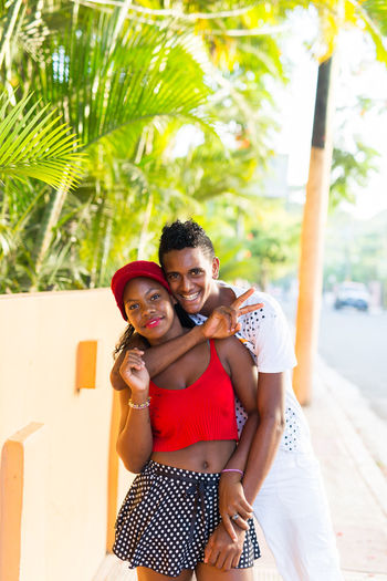Young Love #eabreudr #thedominicanrepublic #dominicanrepublic #republicadominicana #eabreutravels #travelphoto #travelphotography #travel #canon_official #canon_photos #canon #canonphotography #canonphoto canon5dmarkiii Leisure Activity Lifestyles Tree Palm Tree Looking At Camera Togetherness Casual Clothing Young Adult Person Young Women Weekend Activities Front View Holding Focus On Foreground Day Vacations