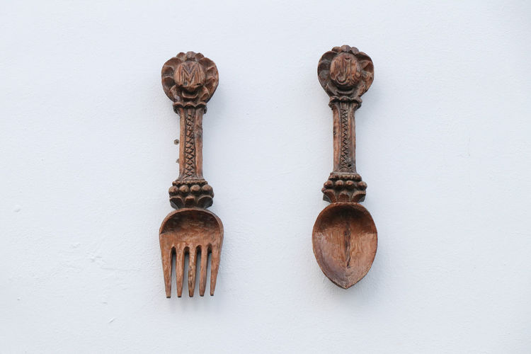 Old cutlery decoration Indoors  No People Wall - Building Feature White Background Still Life Wood - Material Metal Antique Old Side By Side Close-up Three Objects Studio Shot Variation Choice Rusty Group Of Objects Brown Two Objects