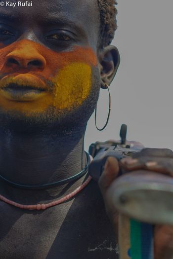 Untold Stories The intimidating stares of a Mursi tribesman in the village of Hayloha in the southern Omo river region of Ethiopia Tribe Ethiopia Portrait Facestories Mursi Klashnekoff Facepaint