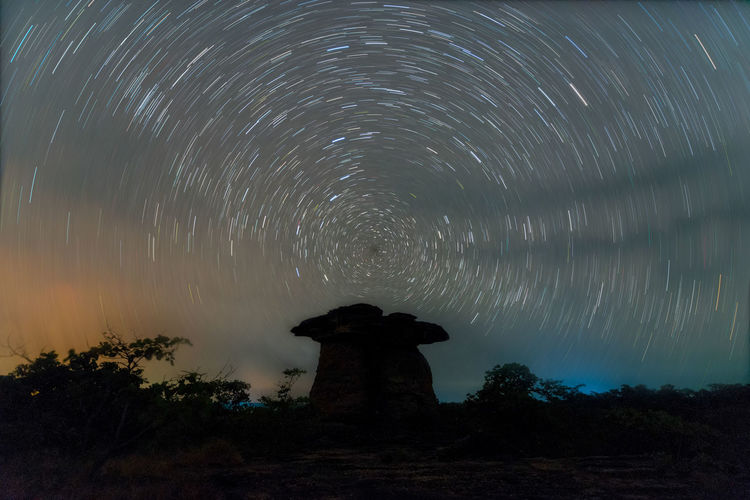 Milky way galaxy with stars in Thailand Star - Space Night Sky Space Long Exposure Scenics - Nature Astronomy Star Trail Tree Motion Beauty In Nature Nature Tranquility No People Plant Star Tranquil Scene Star Field Low Angle View Blurred Motion Outdoors Concentric
