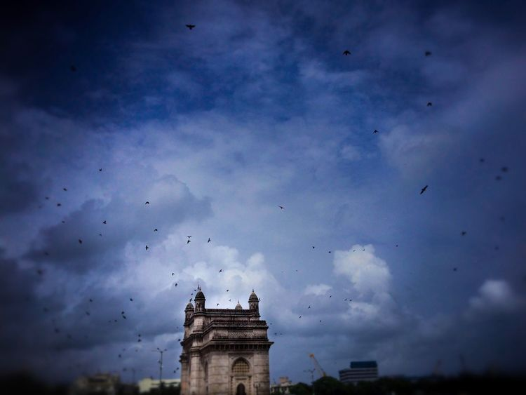Architecture Sky Built Structure Cloud - Sky Building Exterior Low Angle View History Bird Animal Themes No People Large Group Of Animals Outdoors Animals In The Wild Flying Day Nature Getwayofindia Cloud IPhoneography