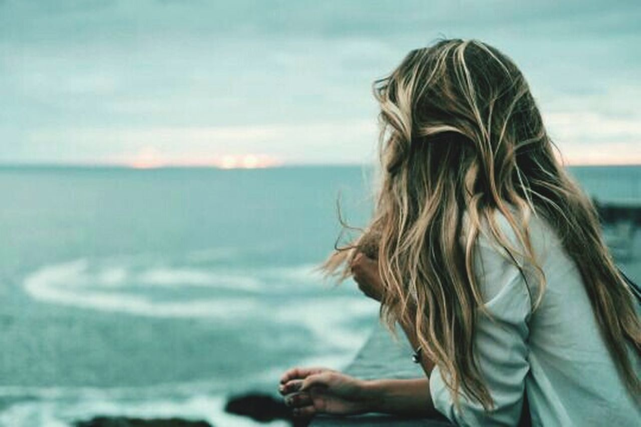 sea, beach, horizon over water, long hair, one person, blond hair, one woman only, only women, water, one young woman only, people, day, wind, side view, adults only, wave, outdoors, sky, nature, water's edge, vacations, headshot, adult, beautiful woman, beauty, close-up, young adult