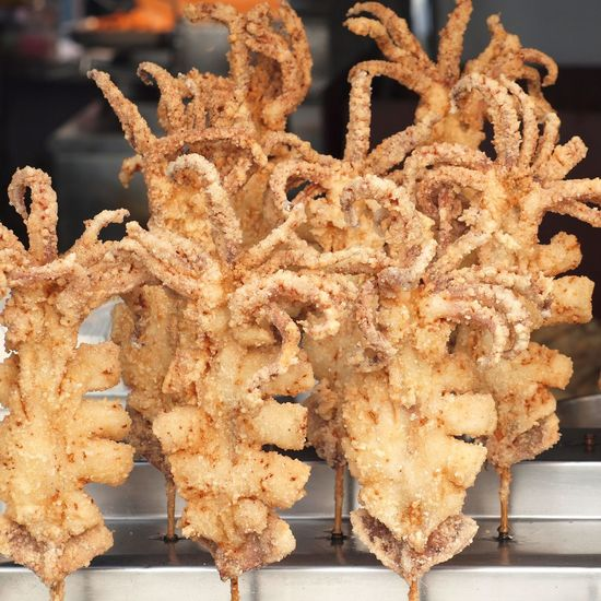 Deep fried octopus on skewers for sale at an outdoor stall Chinese Food Deep Fried Food Food Fried Crispy Octopus Ready-to-eat Seafood Skewers Street Food
