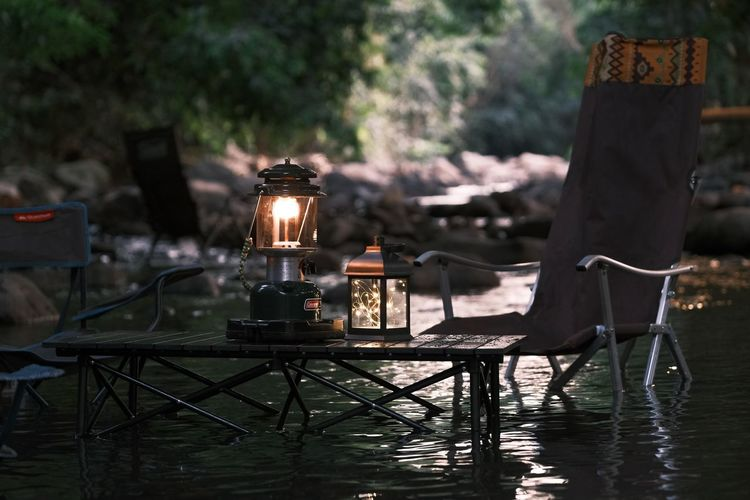 Illuminated lantern on table