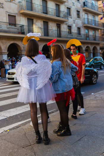 Carnaval des scolaires Lifestyles Architecture Full Length City Building Exterior Built Structure Rear View Group Of People Women Street Real People Day Standing Togetherness People Females Costume Child Transportation Clothing Hairstyle