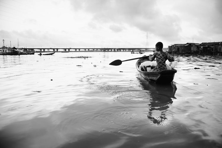 A girl and a canoe TheWeekOnEyeEM Beach Beauty In Nature Child Cloud - Sky Day Land Leisure Activity Lifestyles Men Nature One Person Outdoors Real People Reflection Sea Sky Transportation Water Waterfront