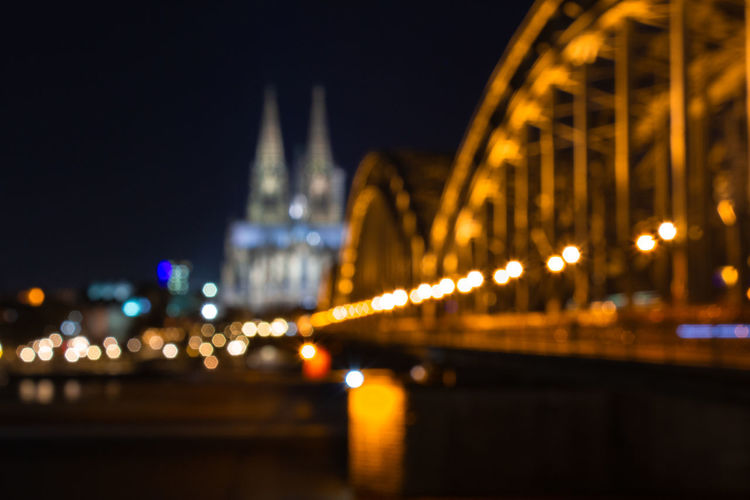Cologne skyline with Cologne Cathedral and Hohenzollern bridge at night Cologne Cologne Cathedral Cathedral Night Illuminated Built Structure Architecture Travel Destinations City Bridge - Man Made Structure Bridge Connection Building Exterior Tourism Transportation No People Travel River City Life Water Nature Building Outdoors Skyscraper Cityscape