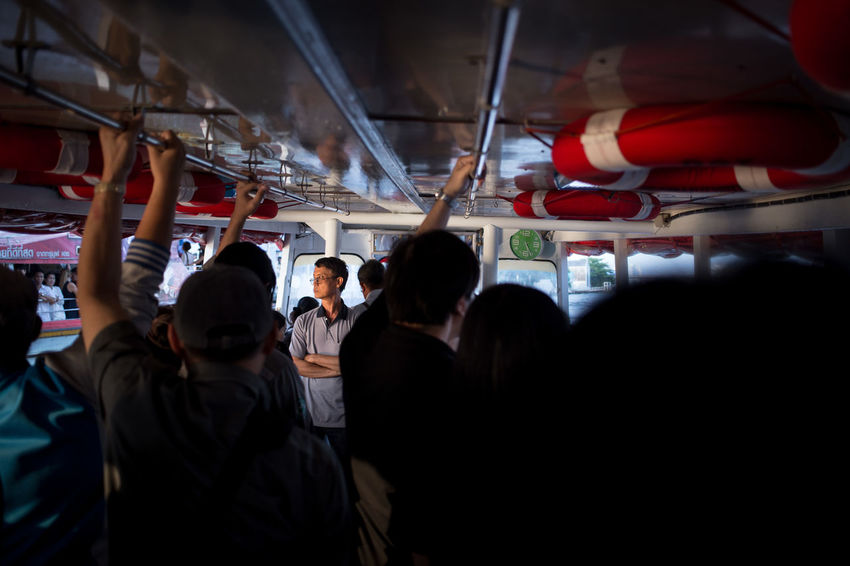 Commuters on the Chao Phraya river ferry in Bangkok, Thailand Boat Communication Commuters Crowd Ferry Ferryboat Journey Large Group Of People Mode Of Transport Photojournalism Public Transportation Reportage River Boat Single Person Solitude Sunset The Photojournalist - 2017 EyeEm Awards Transport Transportation Transportation