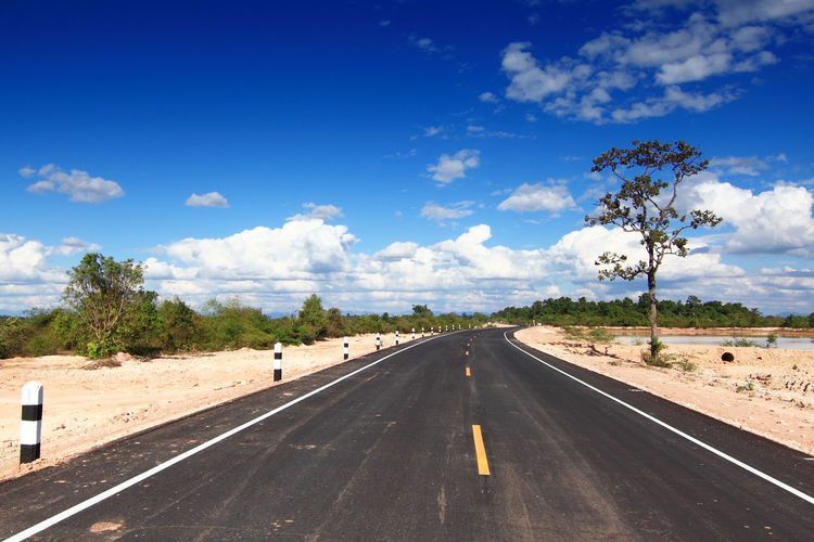 Asphalt Road and Bright Sky Sky Road Cloud - Sky Transportation Symbol Direction Sign Road Marking The Way Forward Marking Nature Tree Day Plant No People Diminishing Perspective vanishing point Sunlight Landscape Outdoors Dividing Line Long