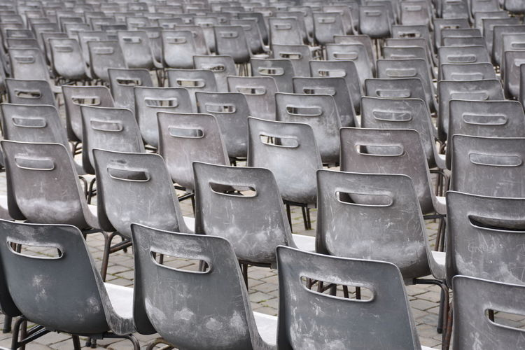 Full Frame Shot Of Empty Chairs Arranged