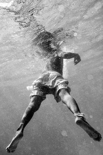 Low angle view of man in underwater