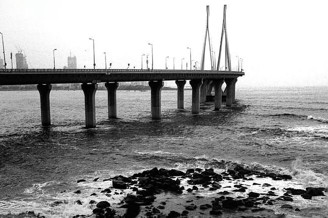 One always wonders about roads not taken. -Warren Christopher Rainslove_photography Rainy Days Bandra Worli Sea Link Blackandwhite Photography Bnw_collection Pictureoftheday Spotlight
