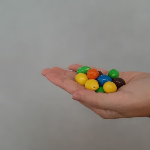 sweets Chocolate Sweet Sweet Food Candy Close-up Still Life Less Is More Human Hand Multi Colored Studio Shot Candy Healthy Lifestyle Easter Handful Holding Body Part Hand Finger Human Finger Personal Perspective Index Finger