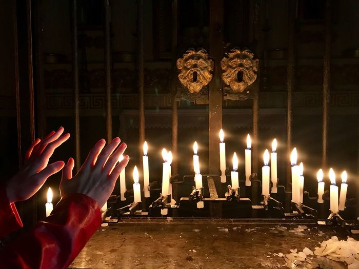 Sacred. Divine Italy Pisogne Sacred Illuminated Candle Burning Human Hand Glowing Flame Hand Fire Religion Celebration People Spirituality Fire - Natural Phenomenon Real People The Mobile Photographer - 2019 EyeEm Awards