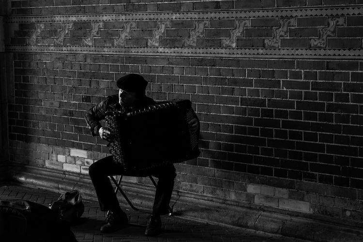 Street musician Accordion Accordionist Black & White Blackandwhite Brick Wall Capital Cities  City Man Street Musician Natural Light Portrait People And Places Monochrome Photography People
