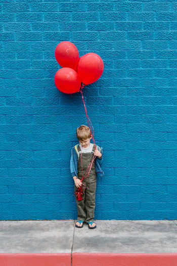 Birthday Balloons Boy With Balloons Red Balloons Balloon Birthday Blue Wall Day One Person Outdoors People Preschooler Toddler