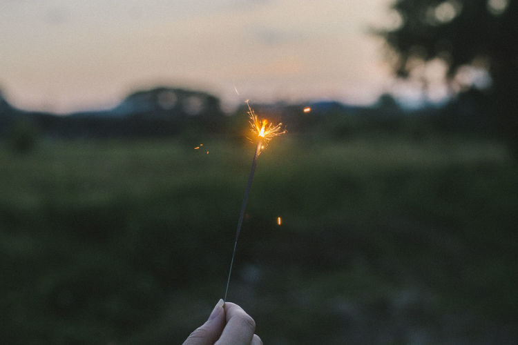 Zimne ognie Zimne Ognie One Person Real People Human Hand Holding Hand Focus On Foreground Human Body Part Burning Unrecognizable Person Lifestyles Leisure Activity Personal Perspective Body Part Sparkler Illuminated Finger Human Finger Nature Fire Outdoors Firework