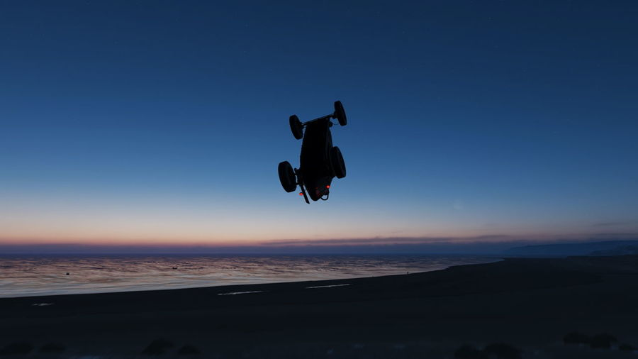 Man jumping against clear sky during sunset
