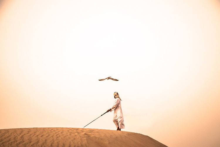 The Arabic Falcon Hunt2 UAE Copy Space Sky One Person Real People Flying Lifestyles Full Length Nature Leisure Activity Day Land Standing Clear Sky Human Arm Adult Men Outdoors Walking
