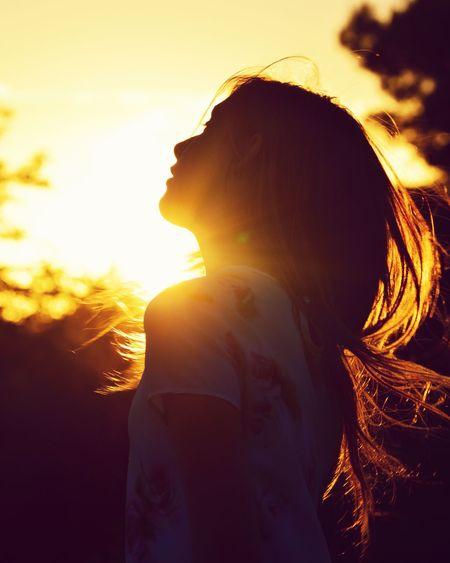 sunset Sunset Sunlight Lifestyles Leisure Activity Sunbeam Sun Sky Orange Color Sunny Nature Long Hair Bright Back Lit Enjoying Beauty In Nature Young Adult Focus On Foreground Lens Flare Scenics Girl Younggirl Arizona Arizona Sunsets Arizona Sunset