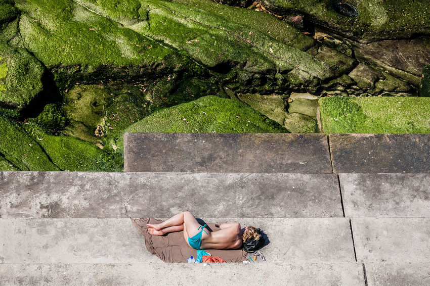 Bondi Beach, Sydney, Australia. I will be teaching an intensive, one day street photography workshop in Sydney with a small group – let me know if you're interested! Read more: http://kulbowski.com/sydney Australia Bondi Beach Travel Photography Workshop Beach Beachphotography Bikini Concrete High Angle View Leisure Activity Lifestyles One Young Woman Only Outdoors Photography Street Photo Street Photographer Street Photography Streetphoto Streetphoto_color Streetphotography Summer Sunbathing Sydney Toplesswoman Travel Destinations