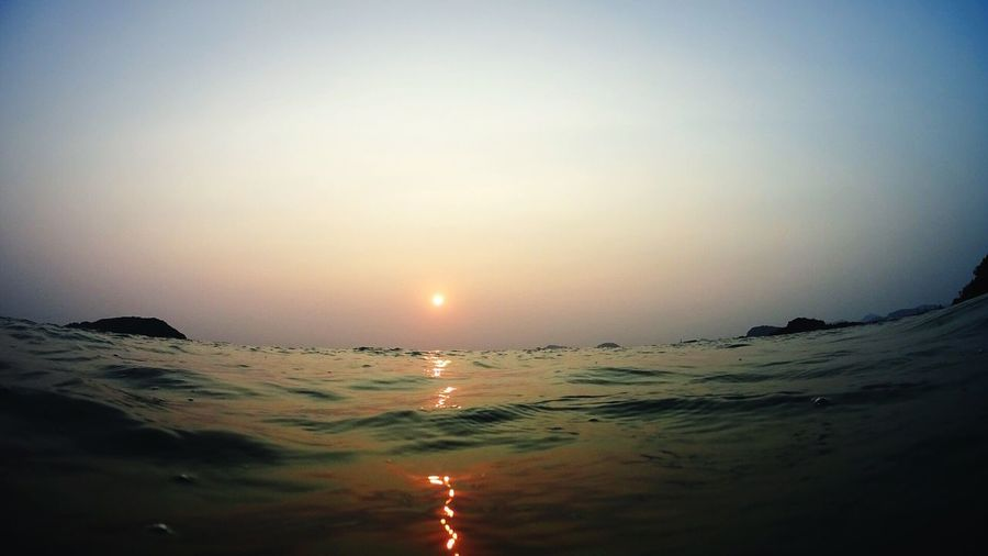 Sea Water Nature Sunset Sky Tranquility Scenics Beauty In Nature Clear Sky Sun Horizon Over Water Tranquil Scene Outdoors No People Beach Day Travel Thailand Swimming Water Surface Dot