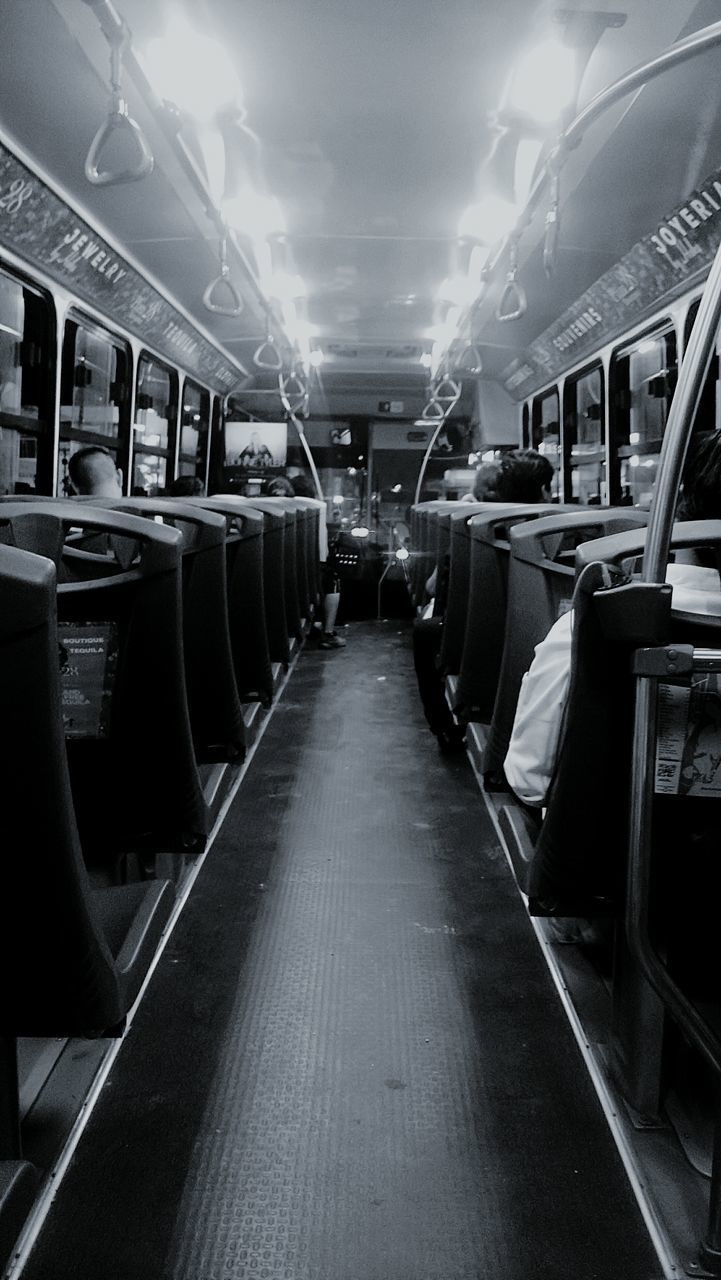 in a row, indoors, no people, illuminated, vehicle seat, day