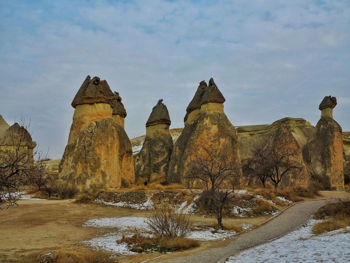 Volcanic Landscape Mushroom Shape Rock Unessco World Heritage Site Beauty In Nature Fairy Chimneys Cappadocia/Turkey Rock - Object Göreme Lunar Landscape Rock Hoodoo Open Air Museum Domestic Animals Travel Destination Fairy Chimneys😝Volcanic Rocks Landmark Senic View Abstract Landscape Low Angle View Snow ❄ Travel Destinations
