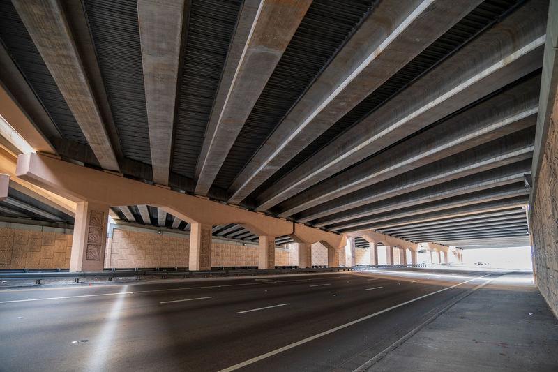 Empty road below elevated bridge