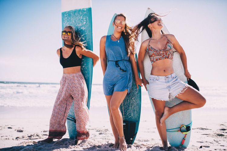 Beach Land Young Adult Young Women Clothing Sea Water Fashion Full Length Group Of People Standing Adult Happiness People Women Nature Holiday Beautiful Woman Outdoors Surfboard Surfing Friendship Vacations Summer