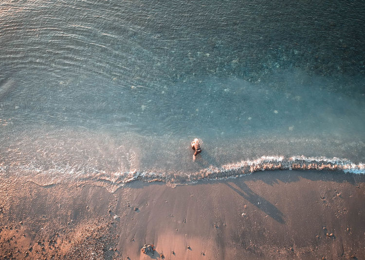 Aerial view of woman at beach
