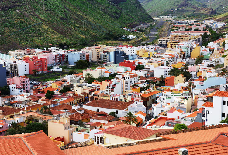 High angle view of townscape by mountain at san sebastian de la gomera
