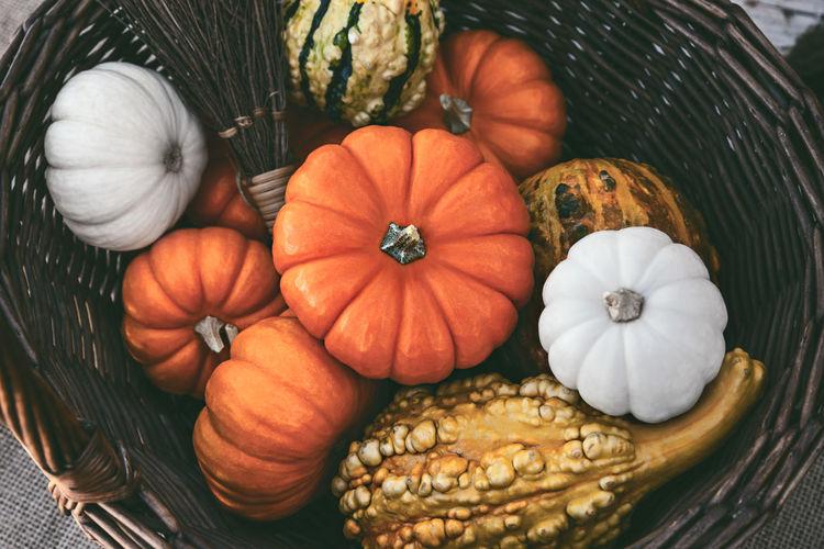 Directly Above Shot Of Pumpkins In Wicker Basket