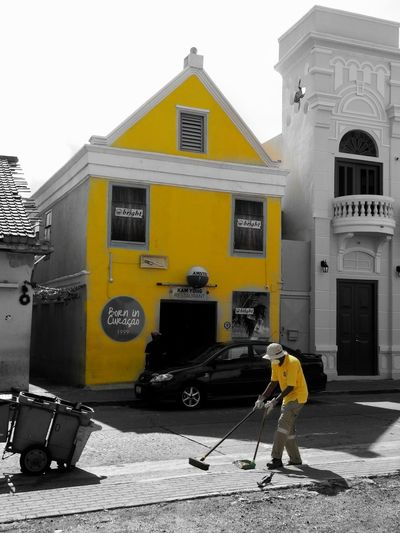Street Cleaner Built Structure Building Exterior Outdoors One Person Architecture City People One Man Only Otrabanda Curacao (willemstad) Curacao Black And White (c) 2016 Shangita Bose All Rights Reserved Monochrome colorsplash Yellow Willemstad Snbcuracao