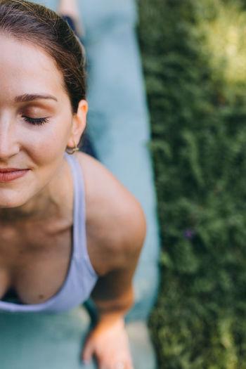 High angle view of woman smiling doing yoga
