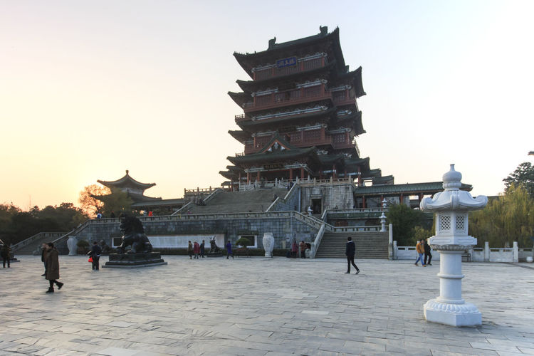 Nanchang, China - December 30, 2015: Tengwang Pavilion in Nanchang at sunset, one of the four famous towers in south China Architectural Column Architecture Art ASIA Built Structure Capital Cities  China Chinese New Year Famous Place History International Landmark Jianxi Metropolis Modern Building Monument Nanchang Outdoors Pagoda Pavilion On Lake Province Sky Tengwang Tourism Tourist Travel Destinations