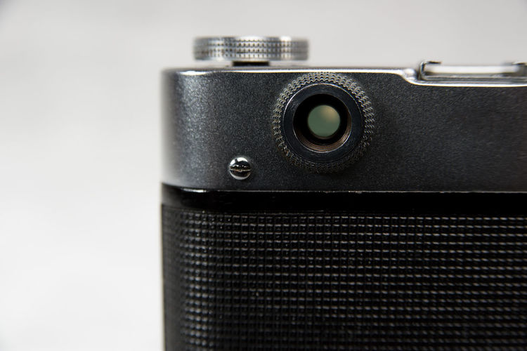 Close-up of camera over white background