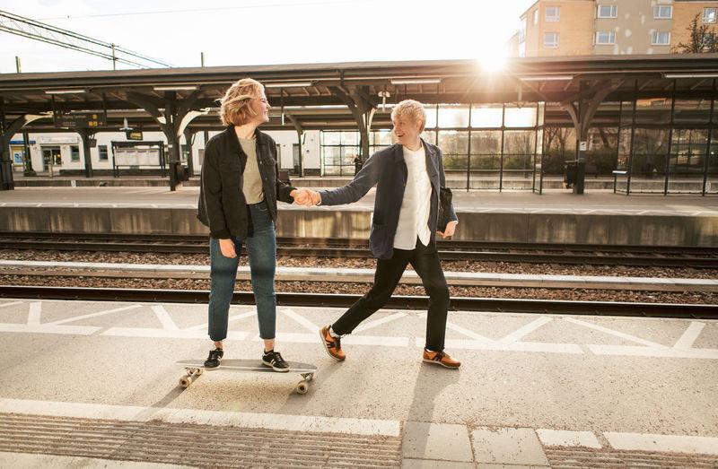 Women standing on railroad station platform